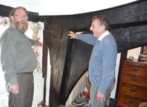 Member Tony Singleton shows owner Philip Cox key features of a Wealden house